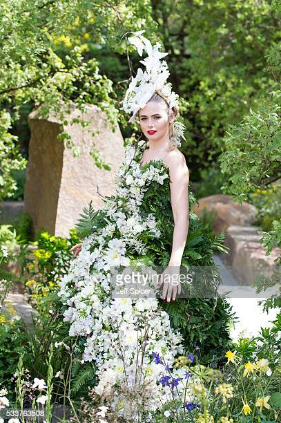 A model in a dress made of flowers at the MG Investments Garden at Chelsea Flower Show press day at Royal Hospital Chelsea on May 23 2016 in London...