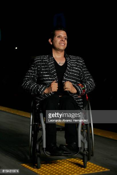 A model in a wheelchair poses during Guatemalan fashion designer Isabella Springmühl show as part of IM Intermoda 2017 at Expo Guadalajara on July 19...