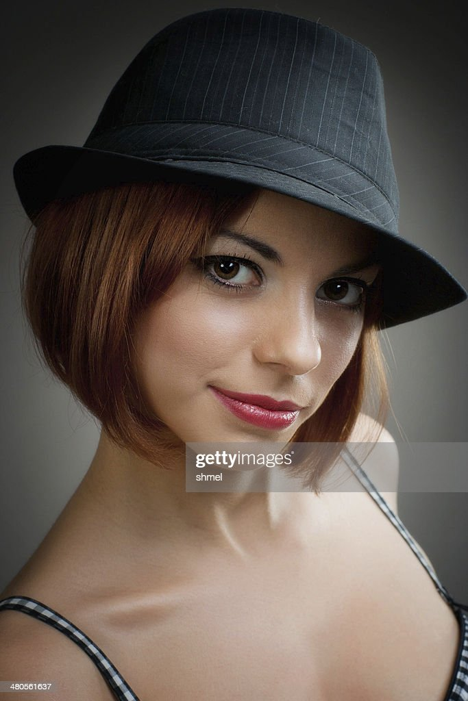 Model in black trilby style hat : Stock Photo
