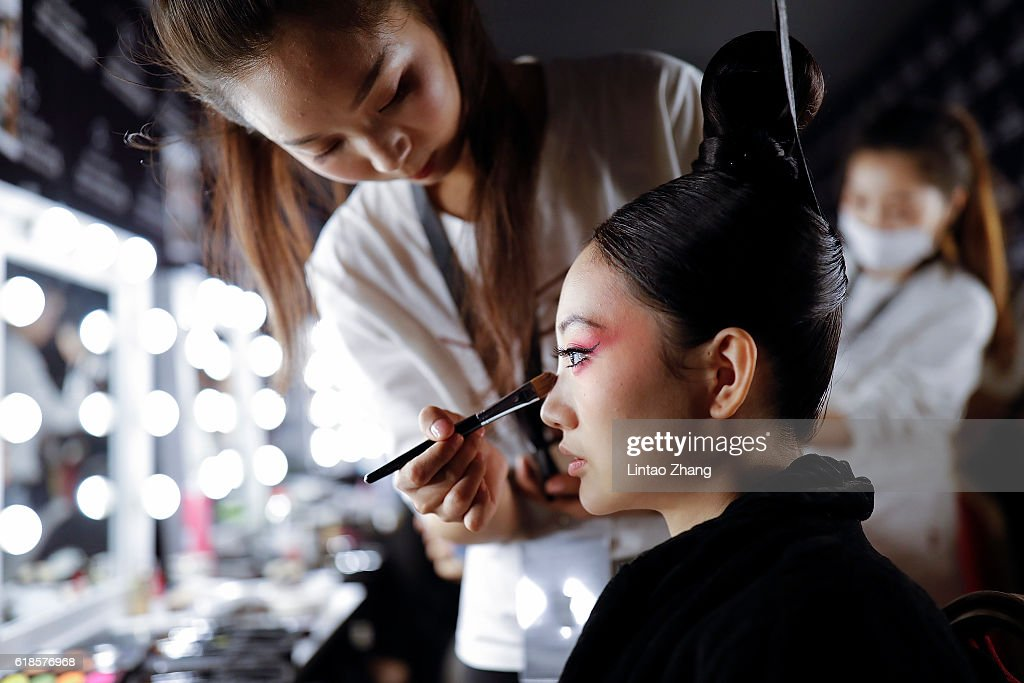 A model in make up before before during the Creative Rongchang Grass Cloth by Yichao Zhang show during Mercedes-Benz China Fashion Week Spring/Summer 2017 at Beijing Hotel on October 27, 2016 in Beijing, China. The fashion week runs from 25 October to 02 November.