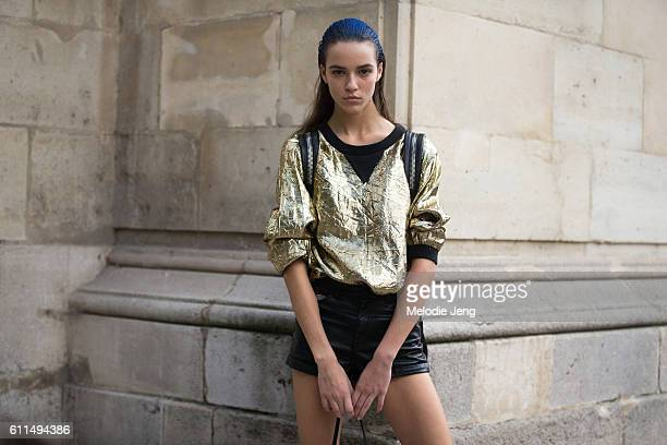 Model in the blue hair from the show outside of the Paco Rabanne show at Jeu de Paume on September 29, 2016 in Paris, France.