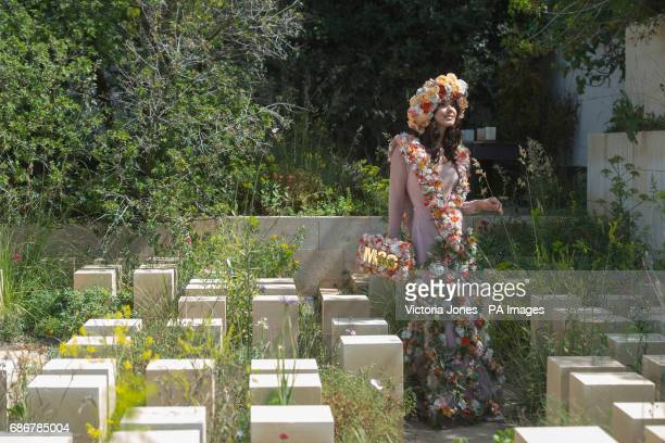 A model in the MampG Garden during the press preview of the RHS Chelsea Flower Show at the Royal Hospital Chelsea London