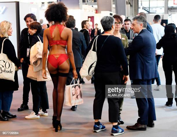 A model in underwear walks in the hall of the Paris Expo Porte de Versailles during the International lingerie fair on January 20 2018 in Paris / AFP...