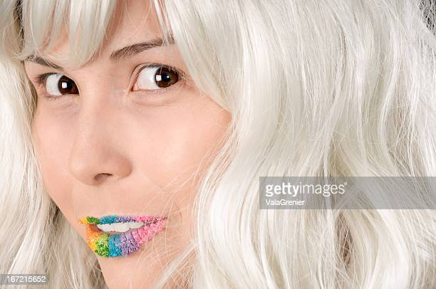 model in white wig and candy lips with shy smile - white hair stock pictures, royalty-free photos & images