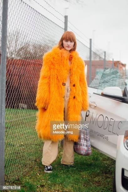 Model Ina Maribo Jensen wears a large long orange Saks Potts shearing coat at Copenhagen Fashion Week Autumn/Winter 18 on February 01 2018 in...