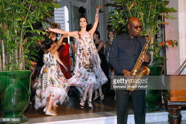 Model including Child Camille walk the runway as Saxophonist Manu Dibango performs during the Franck Sorbier Spring Summer 2018 show as part of Paris...