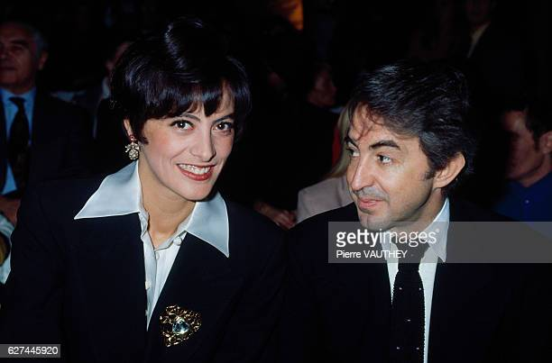 Model Ines de la Fressange and her husband Luigi d'Urso at the haute couture collection preview by designer Claude Montana for French fashion house...