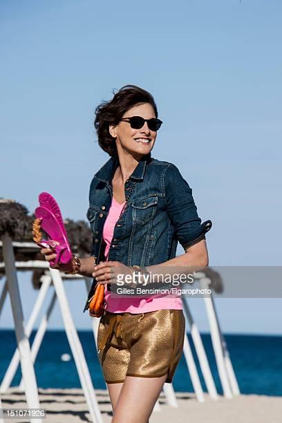 Model Ines de la Fressange poses for Madame Figaro on June 11 2012 in St Tropez France PUBLISHED IMAGE Figaro ID 104235003 Jean jacket by Acquaverde...
