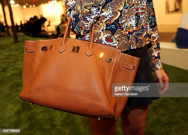 Model Ines Rivero wearing a top by Kenzo a skirt by Isabel Marant and bag by Hermes attends Art Basel Miami Beach 2013 at the Miami Beach Convention...