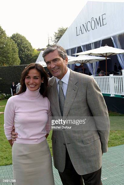 Model Ines Sastres and Vice President of L'Oreal Gilles Weill attend the Trophy Lancome at Golf de SaintNomLaBreteche on September 13 2003 in Paris...