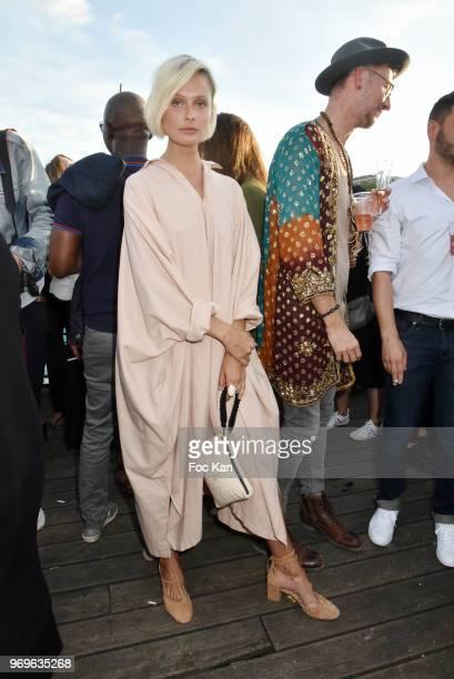 Model Inguna Butane and designer Geoffroy Gillieaux attend 'Ibiza Boheme' Launch Party By BHV Marais on BHV Marais Boat on June 7 2018 in Paris France