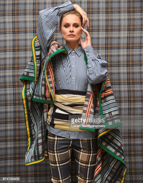 Model Inguna Butane poses at a fashion shoot for Madame Figaro on December 12 2017 in Paris France Shirt top capejacket patns PUBLISHED IMAGE CREDIT...