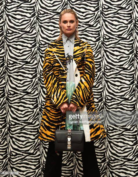Model Inguna Butane poses at a fashion shoot for Madame Figaro on December 12 2017 in Paris France Coat dress pants and bag earring PUBLISHED IMAGE...