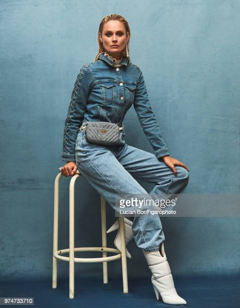 Model Inguna Butane poses at a fashion shoot for Madame Figaro on December 12 2017 in Paris France Jacket jeans blouse bag earring and necklace boots...