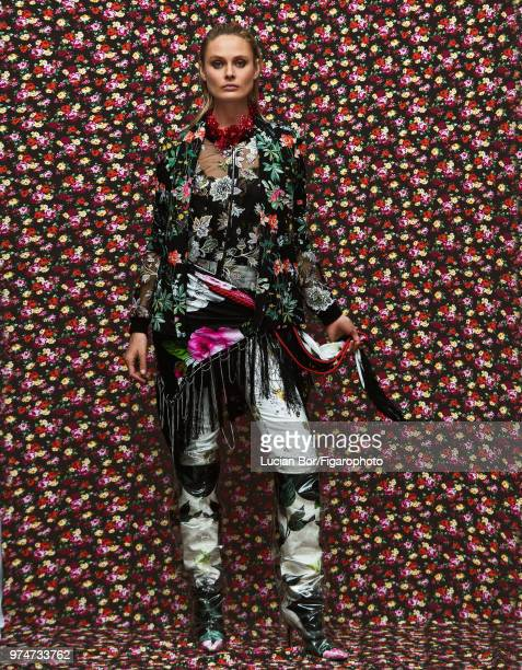 Model Inguna Butane poses at a fashion shoot for Madame Figaro on December 12 2017 in Paris France Jacket blouse top pants scarf boots necklace belt...