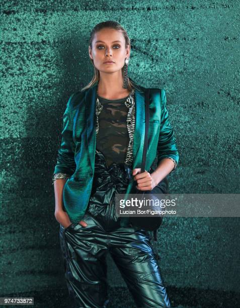 Model Inguna Butane poses at a fashion shoot for Madame Figaro on December 12 2017 in Paris France Jacket shirt tshirt outfit earring bag PUBLISHED...
