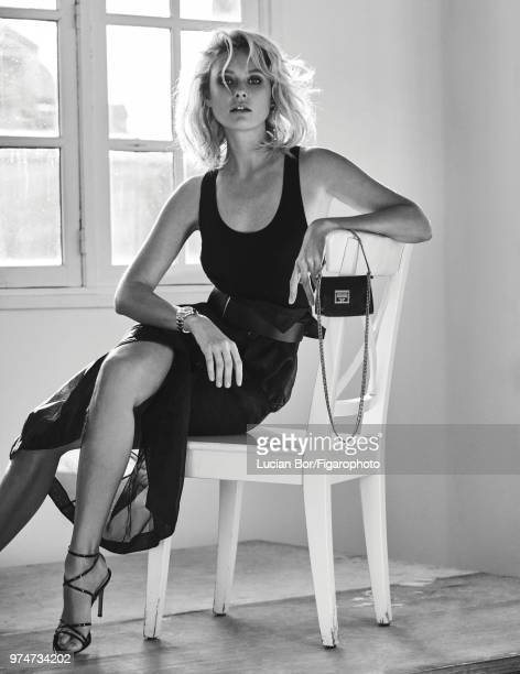 Model Inguna Butane poses at a fashion shoot for Madame Figaro on December 12 2017 in Paris France Tanktop skirt earring watch bag belt shoes...