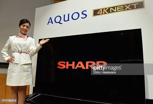 A model introduces the new 80 inch 4K LCD TV Aquos 4K Next of Japan's electronics giant Sharp during a press conference in Tokyo on May 21 2015 Sharp...