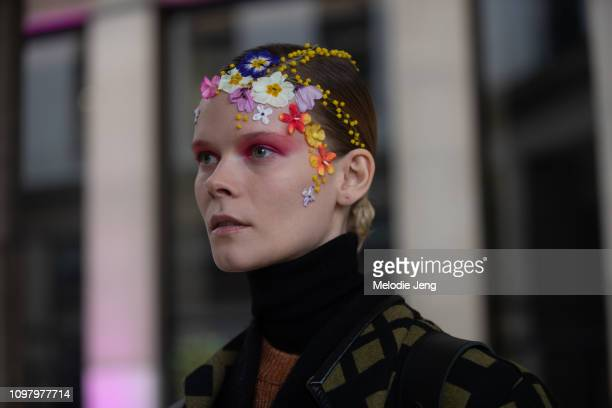 Model Irina Kravchenko with flowers in her hair after the Alexis Mabllle show during Couture Fashion Week Spring/Summer 2019 on January 22 2019 in...