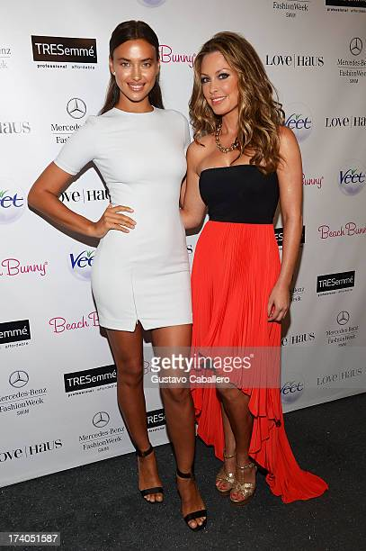 Model Irina Shayk and designer Angela Chittenden attend backstage with TRESemme at the Beach Bunny show during MercedesBenz Fashion Week Swim 2014 at...