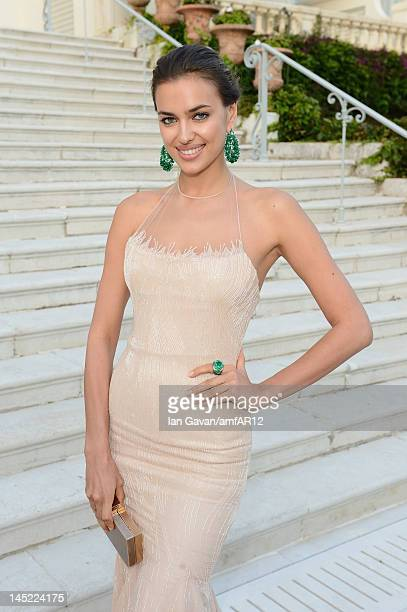 Model Irina Shayk attends the 2012 amfAR's Cinema Against AIDS during the 65th Annual Cannes Film Festival at Hotel Du Cap on May 24 2012 in Cap...