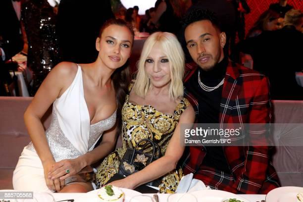 Model Irina Shayk designer Donatella Versace and F1 Driver Lewis Hamilton are seen at The Fashion Awards 2017 in partnership with Swarovski at Royal...