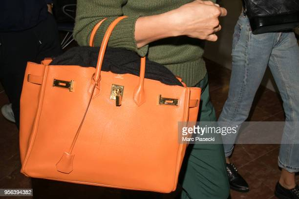 Model Irina Shayk, Hermes Birkin handbag detail, is seen during the 71st annual Cannes Film Festival at Nice Airport on May 9, 2018 in Nice, France.