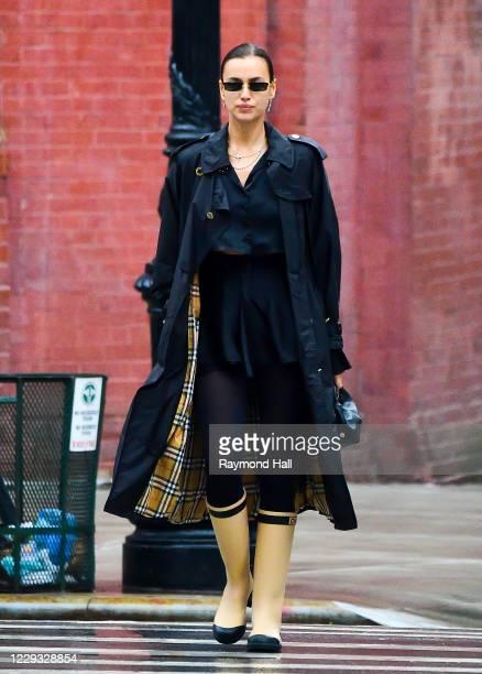 Model Irina Shayk is seen walking in the rain on October 28, 2020 in New York City.