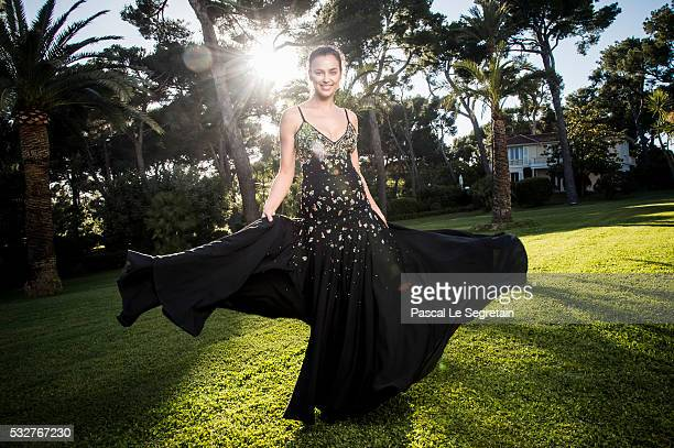 Model Irina Shayk poses for photographs at the amfAR's 23rd Cinema Against AIDS Gala at Hotel du CapEdenRoc on May 19 2016 in Cap d'Antibes France