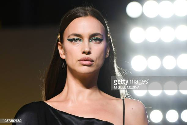 Model Irina Shayk presents a creation for Versace fashion house during the Women's Spring/Summer 2019 fashion shows in Milan on September 21 2018