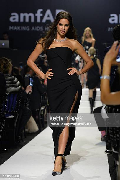 Model Irina Shayk walks during the fashion show runway during amfAR's 22nd Cinema Against AIDS Gala Presented By Bold Films And Harry Winston at...