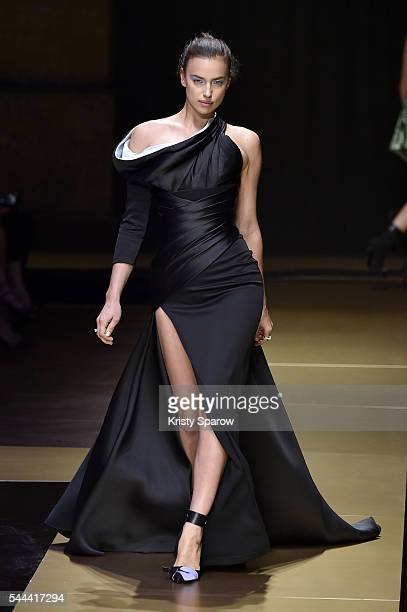 Model Irina Shayk walks the runway during the Atelier Versace Haute Couture Fall/Winter 20162017 show as part of Paris Fashion Week on July 3 2016 in...