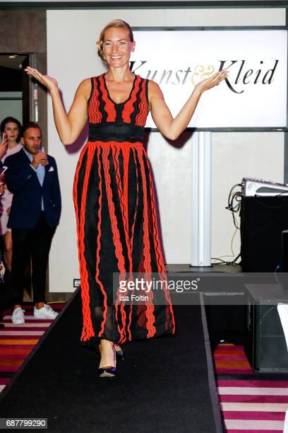 Model Iris Aschenbrenner wlaks the runway during the Kempinski Fashion Dinner on May 23 2017 in Munich Germany