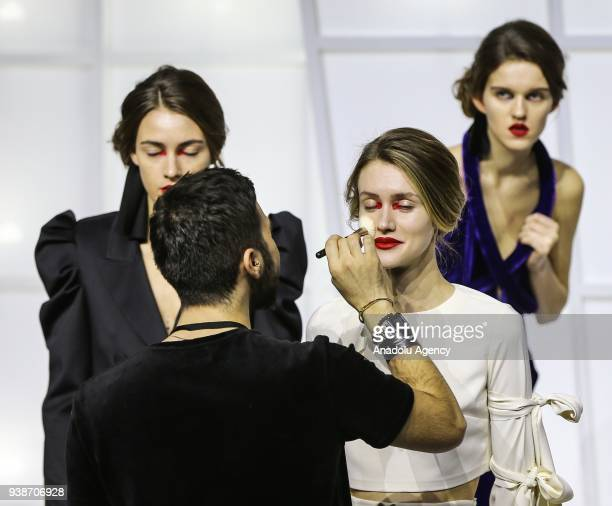 A model is being prepared in backstage for a collection by Ece Kavran to advertise her new brand 'URUN' within Mercedes Benz Fashion Week 2018 in...