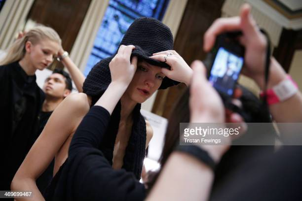 A model is being styled backstage at the Apu Jan show at the Fashion Scout venue during London Fashion Week AW14 at Freemasons Hall on February 16...