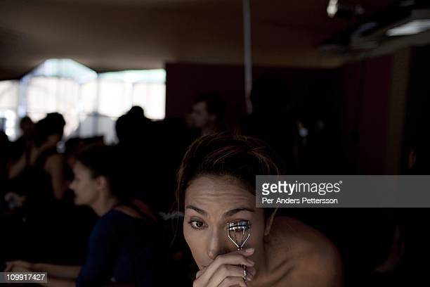 A model is cutting her eyebrows backstage befor a fashion at the Joburg Fashion Week on February 15 in Johannesburg South Africa South Africa's...