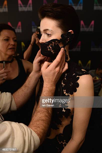 A model is getting styled backstage ahead of the Irene Luft show during MercedesBenz Fashion Week Autumn/Winter 2014/15 at Brandenburg Gate on...