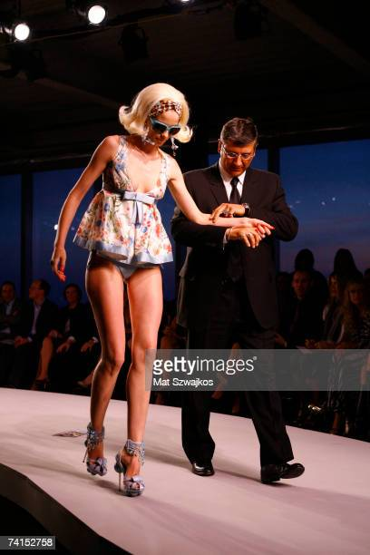 A model is helped down the runway after she fell during the Dior 2008 Cruise collection fashion show on May 14 2007 in New York City