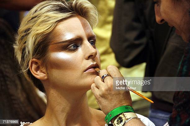 A model is made up backstage at the Christian Dior Fashion show during Paris Fashion Week FallWinter 2006/07 at Polo de Paris July 5 2006 in Paris...