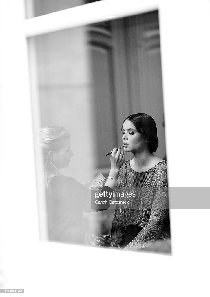 A model is made up backstage before the Frank Sorbier show as part of Paris Fashion Week Haute-Couture Fall/Winter 2013-2014 at Hotel De Bezenval on July 3, 2013 in Paris, France.