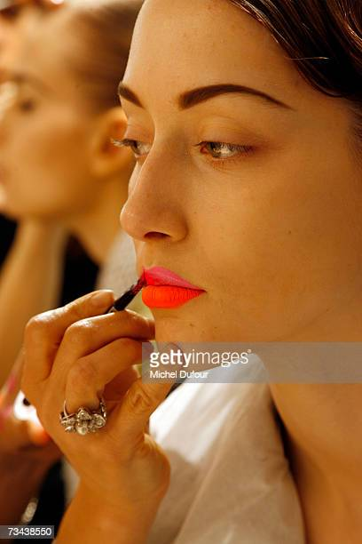 A model is madeup backstage at the Christian Dior Fashion show as part of Paris Fashion Week Autumn/Winter 2008 at Jardin des Tuileries on February...