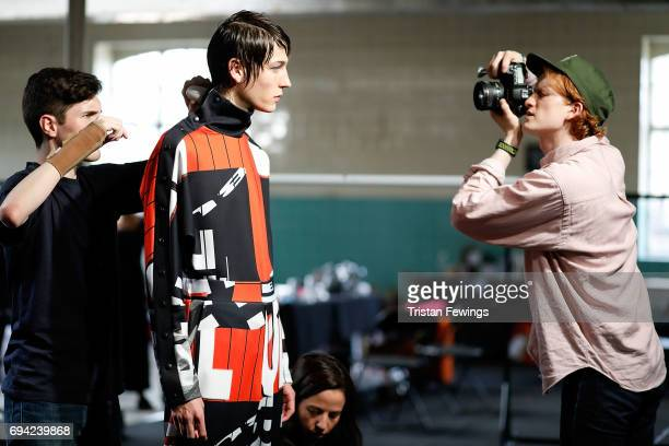 A model is photographed backstage ahead of the TOPMAN Design show during the London Fashion Week Men's June 2017 collections on June 9 2017 in London...