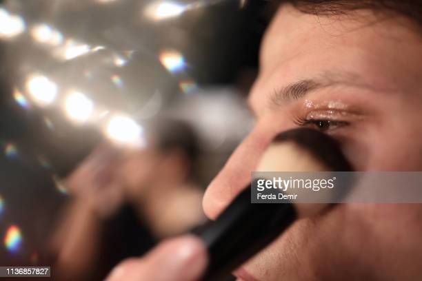 A model is prepared backstage ahead the Damat show during MercedesBenz Istanbul Fashion Week at the Zorlu Performance Hall on March 19 2019 in...