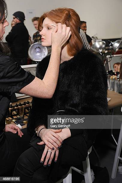 Model is prepared backstage at the ICB By Prabal Gurung Show during Mercedes-Benz Fashion Week Fall 2014 at Eyebeam on February 11, 2014 in New York...