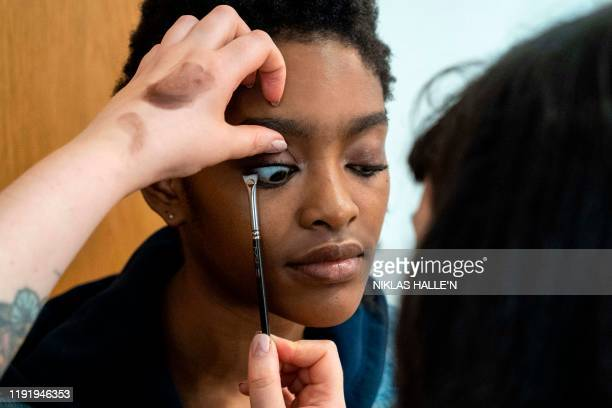 Model is prepared backstage before the catwalk show for fashion brand Wales Bonner on the second day of the Autumn/Winter 2020 London Fashion Week...