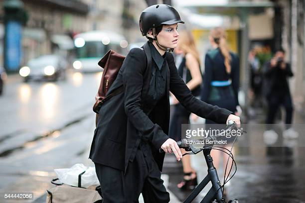 Model is riding a bicycle, after the Atelier Versace show, at Palais Brongniart, during Paris Fashion Week Haute Couture F/W 2016/2017, on July 3,...