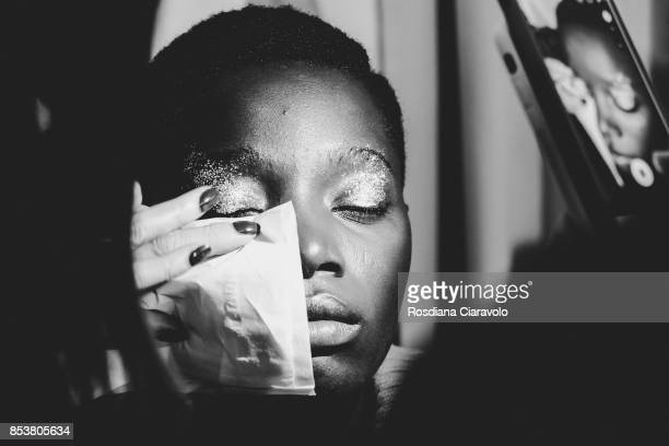 A model is seen ahead backstage of the Stella Jean show during Milan Fashion Week Spring/Summer 2018 on September 24 2017 in Milan Italy