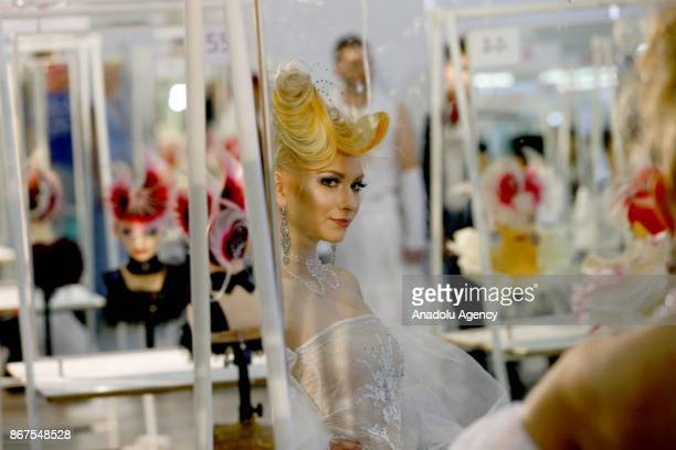A model is seen ahead of the annual InterCHARM 2017 International Perfumery and Cosmetics Exhibition in Moscow Russia on October 28 2017