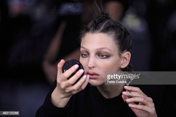 A model is seen at the backstage during Mercedes Benz Madrid Fashion Week Fall/Winter 2015/2016 at Ifema on February 10 2015 in Madrid Spain