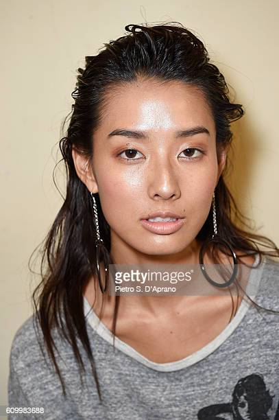 A model is seen backstage ahead of the Atsushi Nakashima show during Milan Fashion Week Spring/Summer 2017 at Palazzo Reale on September 23 2016 in...
